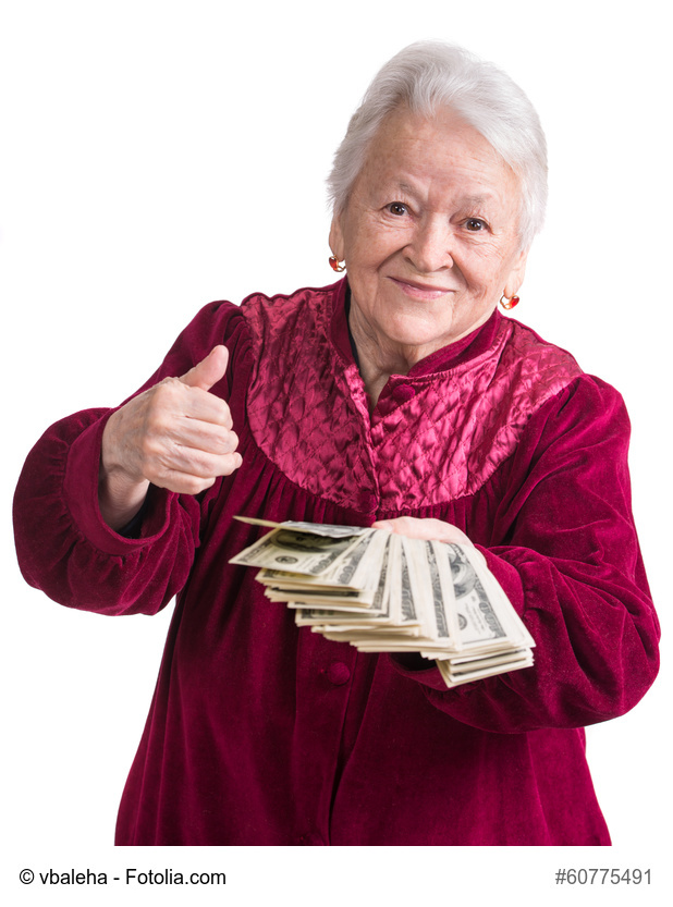 Smiling old woman holding money